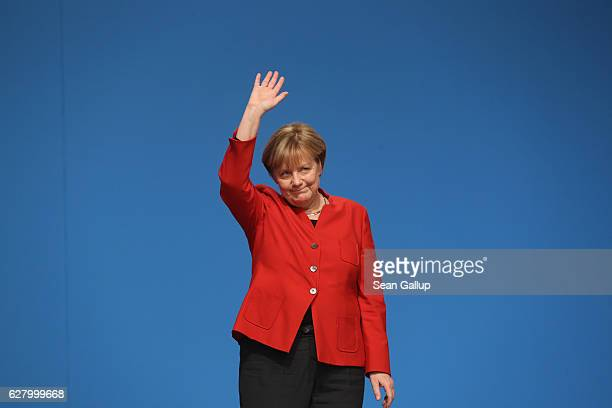 German Chancellor and Chairwoman of the German Christian Democrats Angela Merkel waves to applauding delegates after she gave her central speech at...