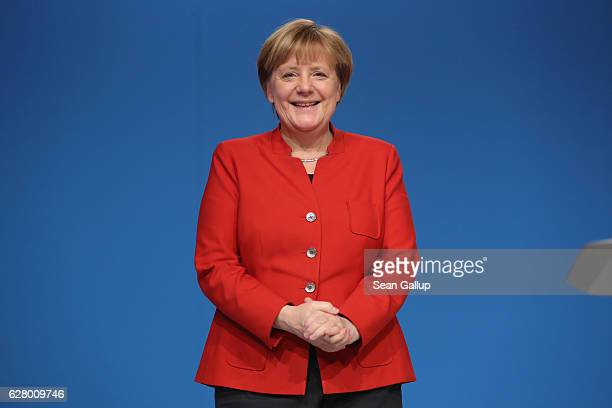 German Chancellor and Chairwoman of the German Christian Democrats Angela Merkel smiles to applauding delegates after she gave her central speech at...