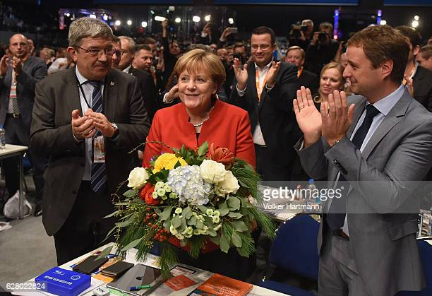 German Chancellor and Chairwoman of the German Christian Democrats Angela Merkel receives applause after she was reelected by delegates as party...