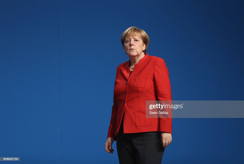 German Chancellor and Chairwoman of the German Christian Democrats (CDU) Angela Merkel walks after she was re-elected with 89.5% of the vote, one of her worst results ever, by delegates as party chairwoman at the 29th federal congress of the CDU on December 6, 2016 in Essen, Germany. Approximately 1,000 CDU delegates are meeting to debate and vote on the party's course for next year following the recent announcement by Merkel that she will run for a fourth term as chancellor in federal elections scheduled for next September.
