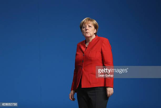 German Chancellor and Chairwoman of the German Christian Democrats Angela Merkel walks after she was re-elected with 89.5% of the vote, one of her...