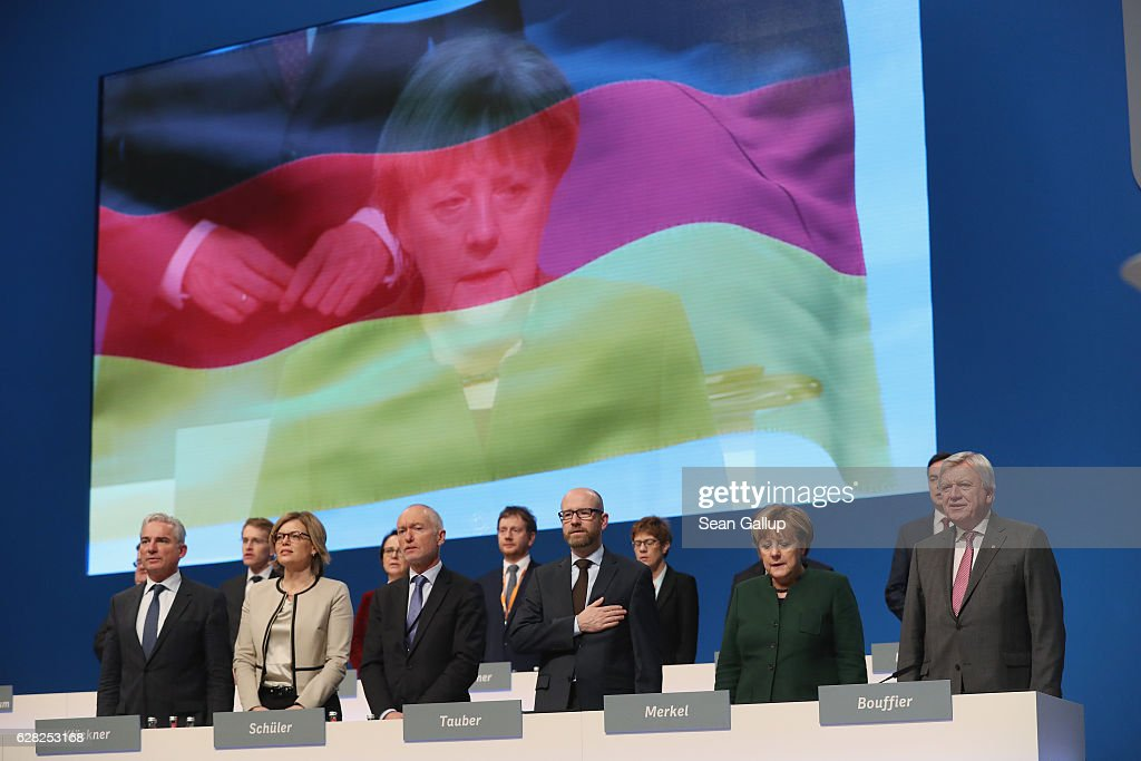 German Chancellor and Chairwoman of the German Christian Democrats (CDU) Angela Merkel and leading embers of her party sing the German naitonal anthem at the conclusion of the 29th federal congress of the CDU on December 7, 2016 in Essen, Germany. Approximately 1,000 CDU delegates are meeting to debate and vote on the party's course for next year following the recent announcement by Merkel that she will run for a fourth term as chancellor in federal elections scheduled for next September.