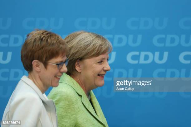 German Chancellor and Chairwoman of the German Christian Democrats Angela Merkel and CDU Saarland lead candidate Annegret KrampKarrenbauer smile as...