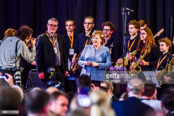 German Chancellor and Chairwoman of the German Christian Democrats Angela Merkel looks on during the CDU campaign rally for state elections in North...