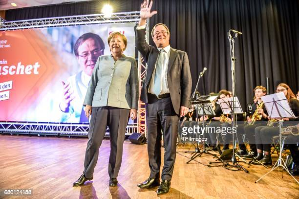 German Chancellor and Chairwoman of the German Christian Democrats Angela Merkel and Armin Laschet local German Christian Democrats lead candidate...