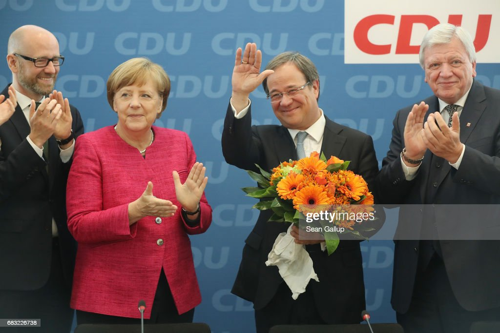 German Chancellor and Chairwoman of the German Christian Democrats Angela Merkel (C-L) and CDU lead candidate in yesterday's state election in North Rhine-Westphalia Armin Laschet (C-R) arrive for a meeting of the CDU governing board as CDU General Secretary Peter Tauber (L) and leading CDU member Volker Bouffier look on on May 15, 2017 in Berlin, Germany. The CDU came in first yesterday in North Rhine-Westphalia, ahead of the German Social Democrats (SPD), in what is a resounding victory for Merkel, as this is the third state election win for the CDU this year. The CDU victory now sets the German Social Democrats (SPD) in an awkward position, as they have been unable to turn the initial popular enthusiasm following the announcement in January that Martin Schulz would run for the SPD for chancellor in to concrete election wins. Germany faces federal elections in September.