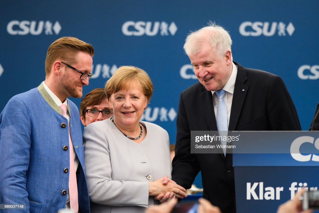 German Chancellor and Chairwoman of the German Christian Democrats (CDU) Angela Merkel and Bavarian Governor and Chairman of the Bavarian Christian Democrats (CSU) Horst Seehofer (R) meet at the Trudering fest on May 28, 2017 in Munich, Germany. The CDU and CSU, along with the German Social Democrats (SPD), form the current German coalition government, though relations between Merkel and Seehofer have been complicated as the two have clashed over certain issues, especially immigration.