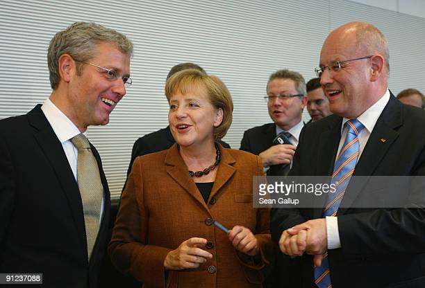 German Chancellor and Chairwoman of the German Christian Democrats Angela Merkel chats with CDU member Norbert Roettgen and CDU Bundestag faction...
