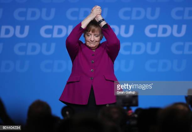 German Chancellor and Chairwoman of the German Christian Democrats Angela Merkel waves to delegates after she spoke at the 30th CDU party congress on...