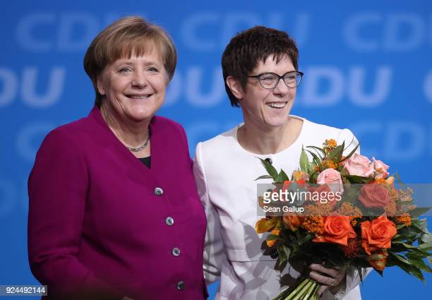 German Chancellor and Chairwoman of the German Christian Democrats Angela Merkel and Annegret Kramp-Karrenbauer smile to delegates moments after...