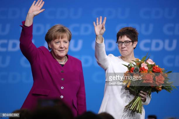 German Chancellor and Chairwoman of the German Christian Democrats Angela Merkel and Annegret Kramp-Karrenbauer wave to delegates moments after...