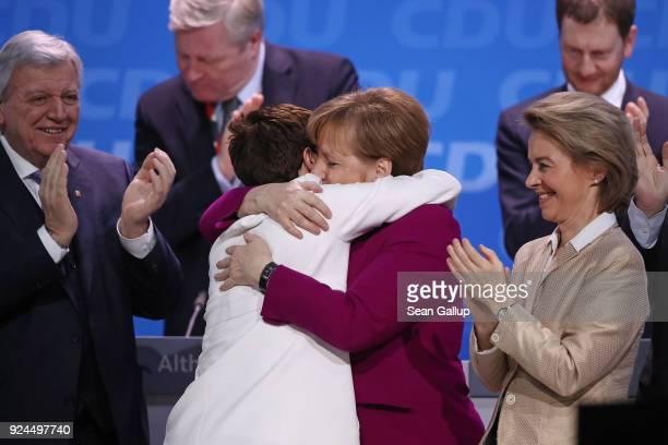 German Chancellor and Chairwoman of the German Christian Democrats Angela Merkel embraces Annegret KrampKarrenbauer moments after KrampKarrenbauer...