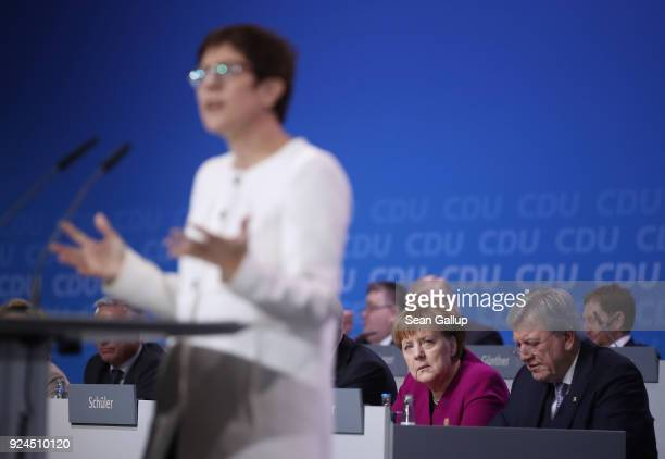 German Chancellor and Chairwoman of the German Christian Democrats Angela Merkel looks on as Annegret KrampKarrenbauer speaks to delegates shortly...