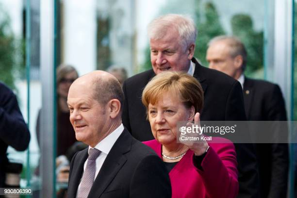 German Chancellor and Chairwoman of the German Christian Democrats Angela Merkel Acting Chairman of the German Social Democrats Olaf Scholz and...