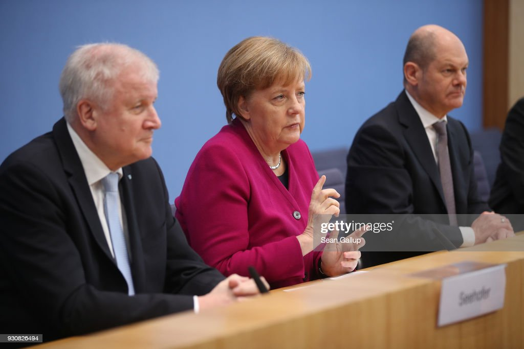 German Chancellor and Chairwoman of the German Christian Democrats (CDU) Angela Merkel (C), Acting Chairman of the German Social Democrats (SPD) Olaf Scholz (R) and Chairman of the Bavarian Christian Democrats (CSU) Horst Seehofer speak to the media prior to this afternoon's signing of the coalition contract by the CDU, SPD and CSU on March 12, 2018 in Berlin, Germany. The German Christian Democrats (CDU), the German Social Democrats (SPD) and the Bavarian Christian Democrats (CSU) will sign the coalition contract that will create the next German government. The new government will be sworn in this coming Wednesday.
