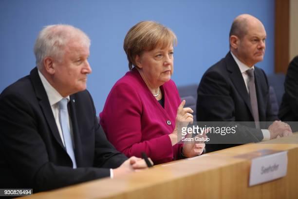 German Chancellor and Chairwoman of the German Christian Democrats Angela Merkel Acting Chairman of the German Social Democrats Olaf Scholz and...