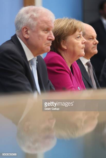 German Chancellor and Chairwoman of the German Christian Democrats Angela Merkel , Acting Chairman of the German Social Democrats Olaf Scholz and...
