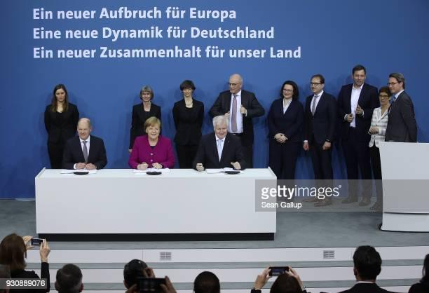 German Chancellor and Chairwoman of the German Christian Democrats Angela Merkel , Acting Chairman of the German Social Democrats Olaf Scholz and...