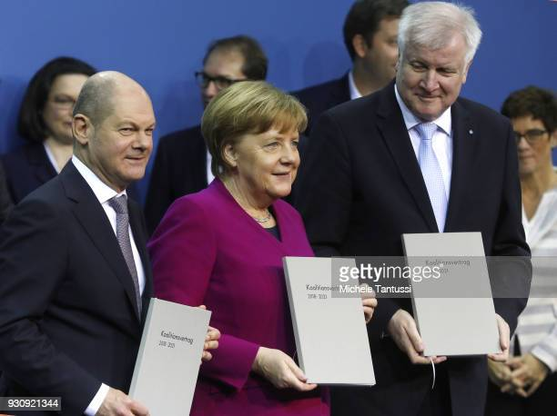 German Chancellor and Chairwoman of the German Christian Democrats Angela Merkel Acting Chairman of the German Social Democrats Olaf Scholz L and...