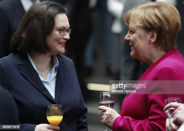 German Chancellor and Chairwoman of the German Christian Democrats Angela Merkel chats with Andrea Nahles Leader of the SPD and chief of the Fraction...