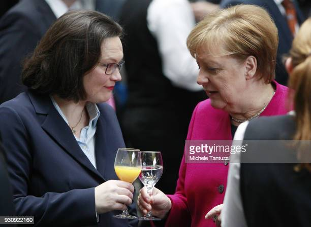 German Chancellor and Chairwoman of the German Christian Democrats Angela Merkel toasts with Andrea Nahles L Leader of the SPD and chief of the...