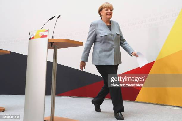 German Chancellor and Christian Democrat Angela Merkel arrives at CDU headquater to speak to the media the day after the CDU won 329% of the vote and...