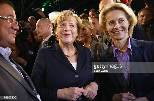 German Chancellor and Christian Democrat Angela Merkel chats with journalists and other visitors including Minister of Work and Social Issues Ursula...
