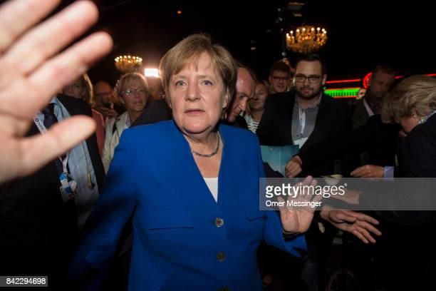 German Chancellor and Christian Democrat Angela Merkel is seen arriving at the journalists hall at the Adlershof television studios after the live...