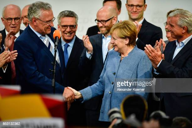 German Chancellor and Christian Democrat Angela Merkel Joachim Herrmann and other members of CDU react to initial results that give the party 33% of...