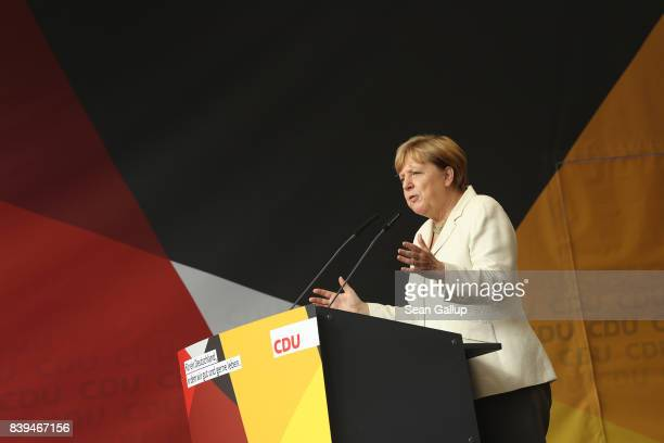 German Chancellor and Christian Democrat Angela Merkel speaks at an election campaign stop on August 26 2017 in Quedlinburg Germany Merkel is seeking...