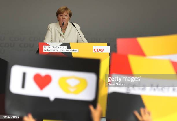 German Chancellor and Christian Democrat Angela Merkel speaks to supporters at an election campaign stop on August 26 2017 in Quedlinburg Germany...