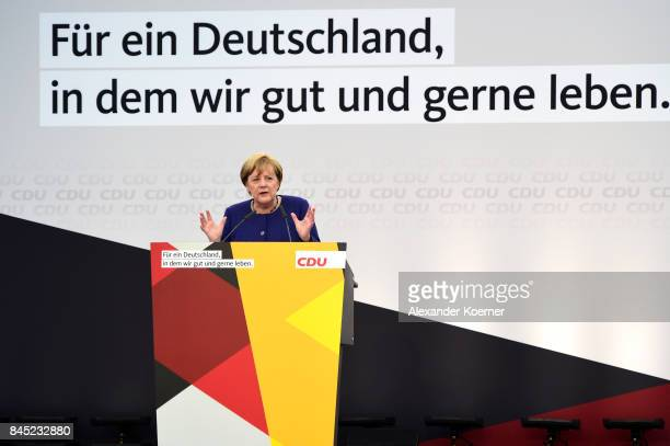 German Chancellor and Christian Democrat Angela Merkel speaks to supporters at a fest tent during an election campaign stop on September 10 2017 in...