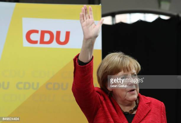 German Chancellor and Christian Democrat Angela Merkel waves upon her arrival at an election campaign stop on September 19 2017 in Wismar Germany...