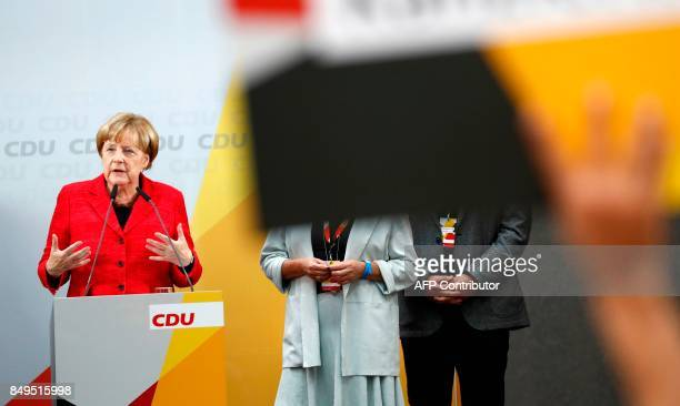 German Chancellor and Christian Democratic Union's main candidate Angela Merkel delivers a speech at an election rally in Wismar northern Germany on...
