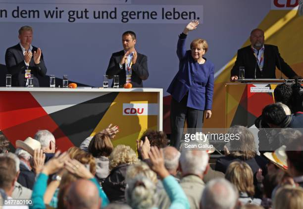 German Chancellor and Chrstian Democrat Angela Merkel waves after speaking at an election campaign stop on the island of Ruegen on September 16 2017...