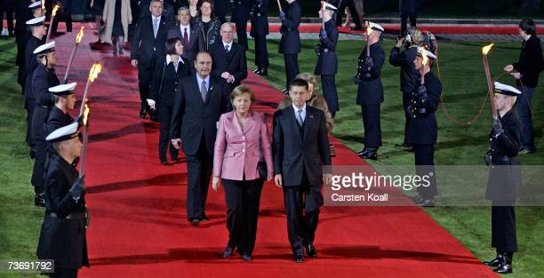 German Chancellor and current President of the European Council Angela Merkel and her husband Joachim Sauer followed by french President Jaques...