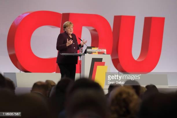 German Chancellor and former leader of the German Christian Democrats Angela Merkel speaks at the 32nd federal congress of the German Christian...