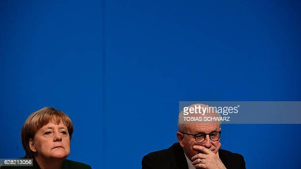 German Chancellor and Head of the Christian Democratic Union Angela Merkel and party member Volker Kauder attend a party's congress in Essen western...