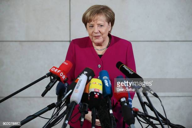 German Chancellor and head of the German Christian Democratic Union Angela Merkel speaks to he media as she arrives at the headquarters of the German...
