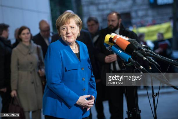 German Chancellor and head of the German Christian Democratic Union Angela Merkel arrives at the headquarters of the German Social Democrats for the...
