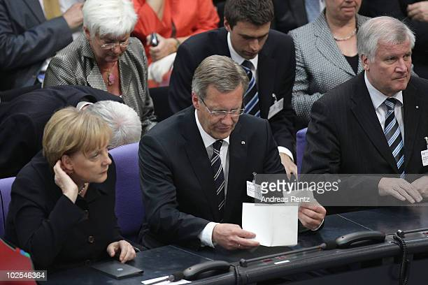 German Chancellor and head of the German Christian Democrats Angela Merkel and presidential candidate Christian Wulff and Bavarian Christian...