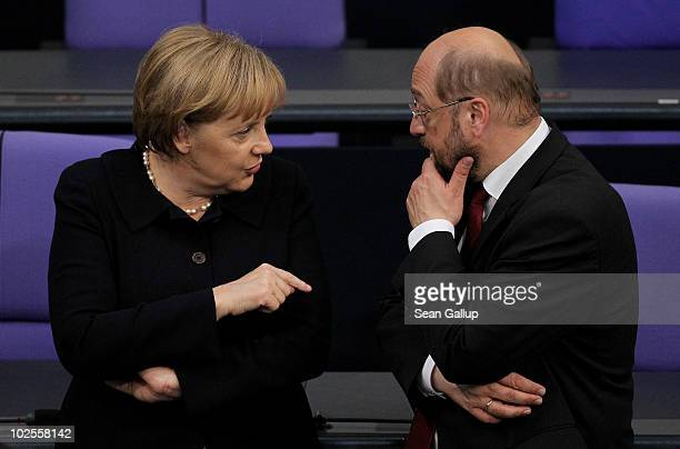 German Chancellor and head of the German Christian Democrats Angela Merkel chats with Martin Schulz Chairman of the Social Democratic faction in the...