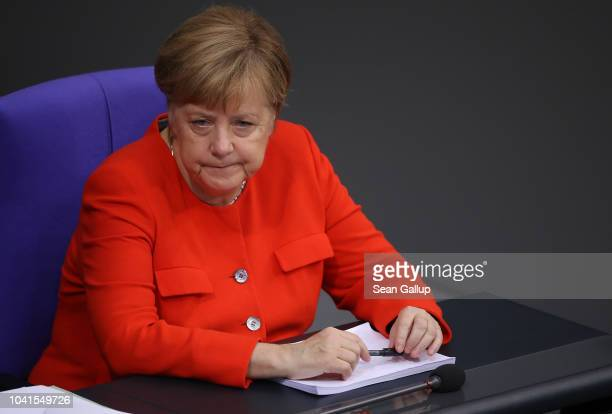 German Chancellor and head of the German Christian Democrats Angela Merkel attends a plenary session at the Bundestag on September 27 2018 in Berlin...