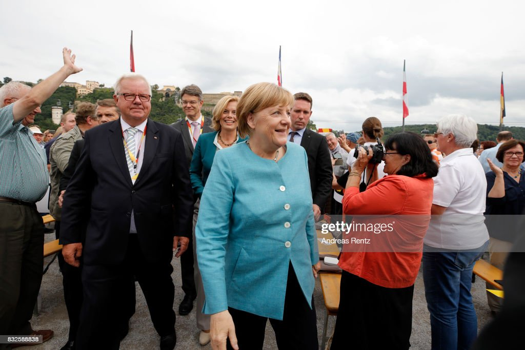 German Chancellor and head of the German Christian Democrats (CDU) Angela Merkel arrives for an election rally at the headland known as the 'Deutsches Eck' ('German Corner'), where the Mosel and Rhine rivers meet, on August 16, 2017 in Koblenz, Germany. Germany is scheduled to hold federal elections on September 24 and Merkel, who is running for a fourth term as chancellor, currently holds a double-digit lead over Martin Schulz from the German Social Democrats (SPD), her main opponent.