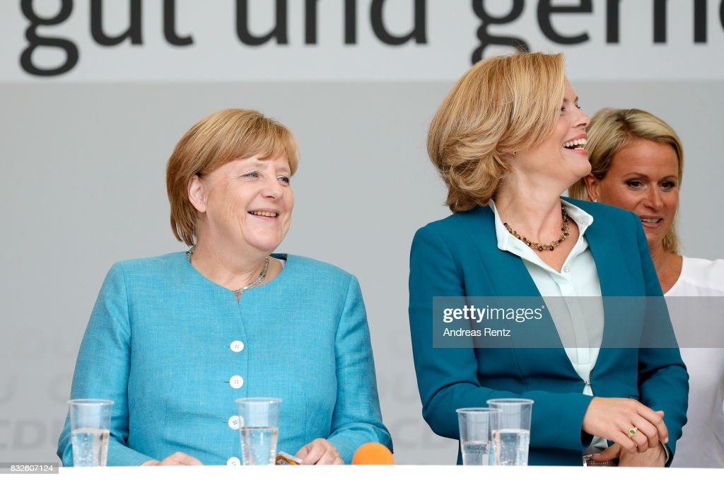 German Chancellor and head of the German Christian Democrats (CDU) Angela Merkel and Chairman of CDU Rheinland-Pfalz Julia Kloeckner are seen on stage during an election rally at the headland known as the 'Deutsches Eck' ('German Corner'), where the Mosel and Rhine rivers meet, on August 16, 2017 in Koblenz, Germany. Germany is scheduled to hold federal elections on September 24 and Merkel, who is running for a fourth term as chancellor, currently holds a double-digit lead over Martin Schulz from the German Social Democrats (SPD), her main opponent.
