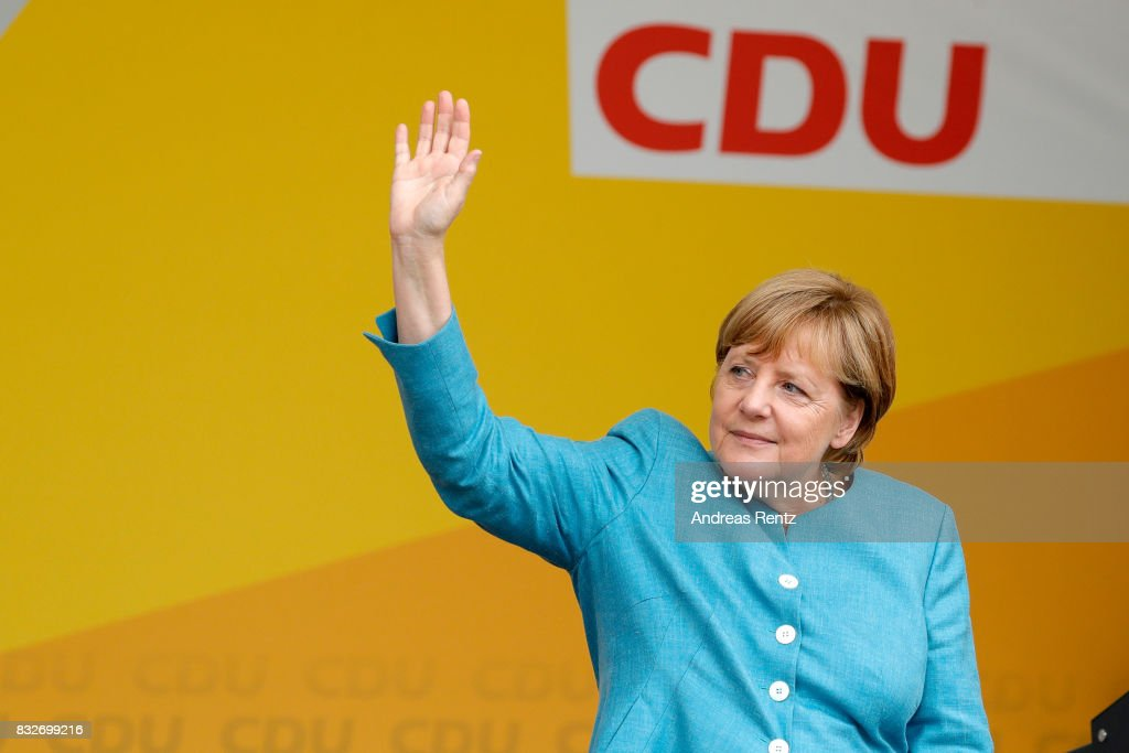 German Chancellor and head of the German Christian Democrats (CDU) Angela Merkel greets supporters after an election rally at the headland known as the 'Deutsches Eck' ('German Corner'), where the Mosel and Rhine rivers meet, on August 16, 2017 in Koblenz, Germany. Germany is scheduled to hold federal elections on September 24 and Merkel, who is running for a fourth term as chancellor, currently holds a double-digit lead over Martin Schulz from the German Social Democrats (SPD), her main opponent.