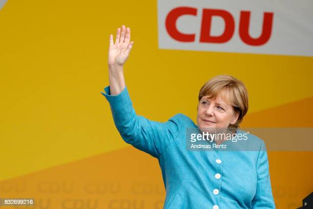 German Chancellor and head of the German Christian Democrats Angela Merkel greets supporters after an election rally at the headland known as the...