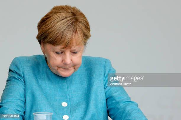 German Chancellor and head of the German Christian Democrats Angela Merkel is seen on stage at an election rally at the headland known as the...