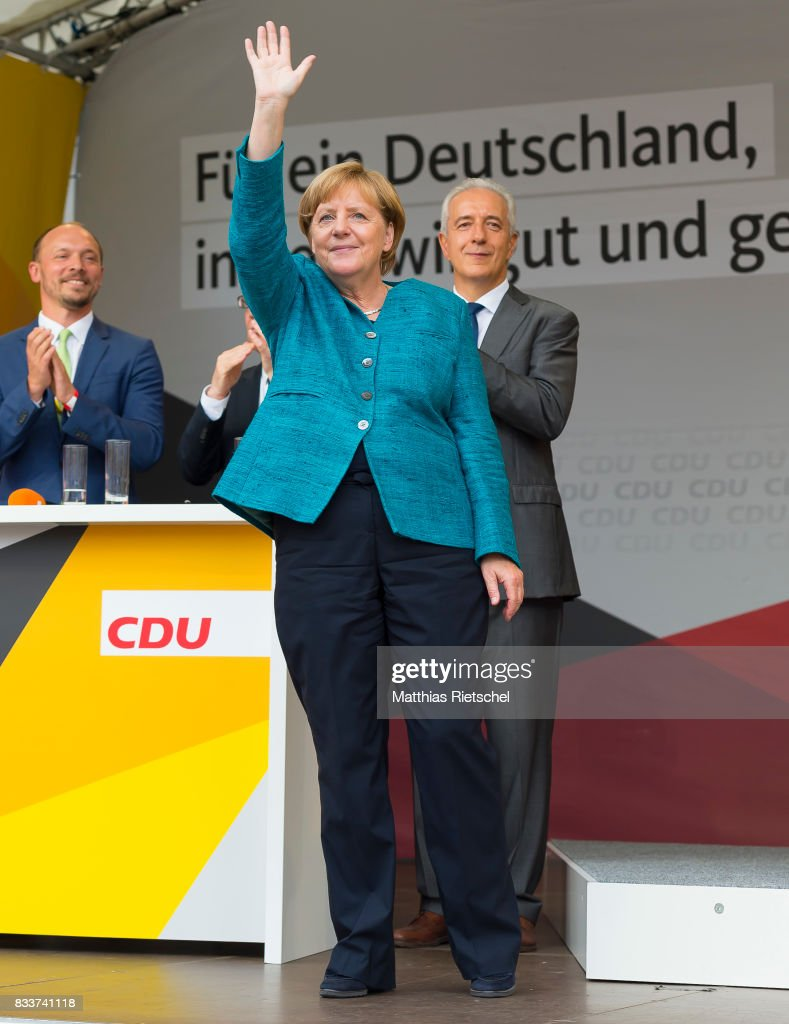 German Chancellor and head of the German Christian Democrats (CDU) Angela Merkel greets supporters after her speech on an election rally in the state of Saxony on August 17, 2017 in Annaberg-Buchholtz, Germany. Germany is scheduled to hold federal elections on September 24 and Merkel, who is running for a fourth term as chancellor, currently holds a double-digit lead over Martin Schulz from the German Social Democrats (SPD), her main opponent.