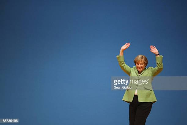 German Chancellor and head of the German Christian Democrats Angela Merkel waves after speaking at a joint meeting of the CDU and its Bavarian sister...
